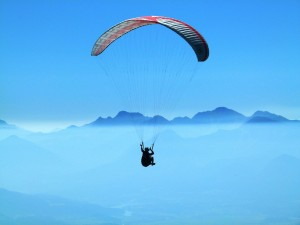 a person is paragliding in the sky